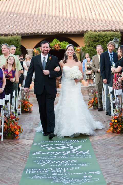 Father Escorts Kelly Up The Aisle